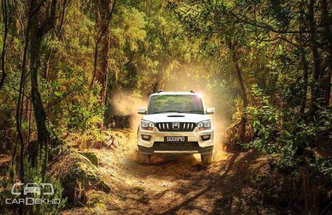Most Striking Mahindra Scorpio Modifications Features CarDekhocom - Dark horse customs car show